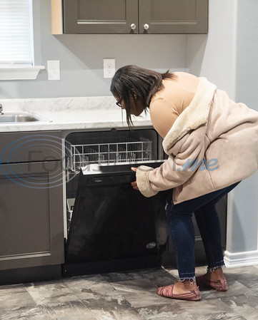 Brea Woods, 17, checks out the new dishwasher in the home she and her mom will live in thanks to Habitat of Humanity on Friday, Oct. 25, 2019. Their new home in Tyler is the 108th home built in Smith County in Habitat's 30-year history.    (Sarah A. Miller/Tyler Morning Telegraph)