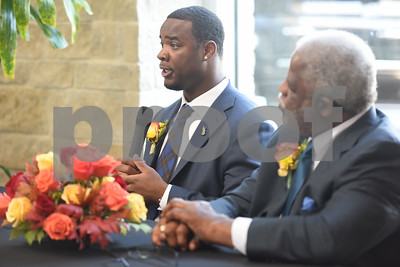 Tyler natives Gary Baxter and Earl Campbell speak during a Thursday press conference at Texas Spine & Joint Hospital announcing a new partnership called the Project Rose Research Institute. The program will be located on the second floor of the hospital and is anticipated to open in 2017.  (Sarah A. Miller/Tyler Morning Telegraph)
