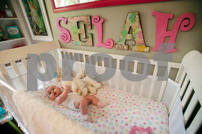 Six-month-old Selah Rose Davis lies down for a nap at her home in Tyler Wednesday Oct. 21, 2015. Lacy and Brandon Davis's other daughter, three-year-old Haven Grace, touched many lives in East Texas before she died in 2012.   (Sarah A. Miller/Tyler Morning Telegraph)