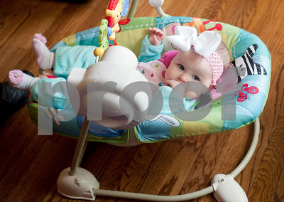 Six-month-old Selah Rose Davis sits in a councer at her home in Tyler Wednesday Oct. 21, 2015. Lacy and Brandon Davis's other daughter, three-year-old Haven Grace, touched many lives in East Texas before she died in 2012.   (Sarah A. Miller/Tyler Morning Telegraph)