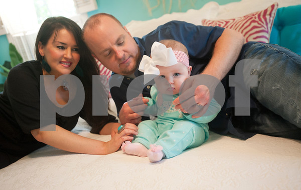 Brandon and Lacy Davis spend time with their daughter 6-month-old Selah Rose Davis at their home in Tyler Wednesday Oct. 21, 2015. The Davis's other daughter, 3-year-old Haven Grace, touched many lives in East Texas before she died in 2012 from a rare heart condition. Haven Grace's story spread nationwide.  (Sarah A. Miller/Tyler Morning Telegraph)
