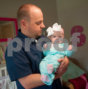 Brandon Davis holds his daughter, six-month-old Selah Rose Davis, at her home in Tyler Wednesday Oct. 21, 2015. The Davis's other daughter, three-year-old Haven Grace, touched many lives in East Texas before she died in 2012.   (Sarah A. Miller/Tyler Morning Telegraph)