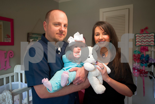 Brandon and Lacy Davis spend hold their daughter six-month-old Selah Rose Davis and a stuffed animal named Lamby at their home in Tyler Wednesday Oct. 21, 2015. The Davis's other daughter, three-year-old Haven Grace, touched many lives in East Texas before she died in 2012.   (Sarah A. Miller/Tyler Morning Telegraph)