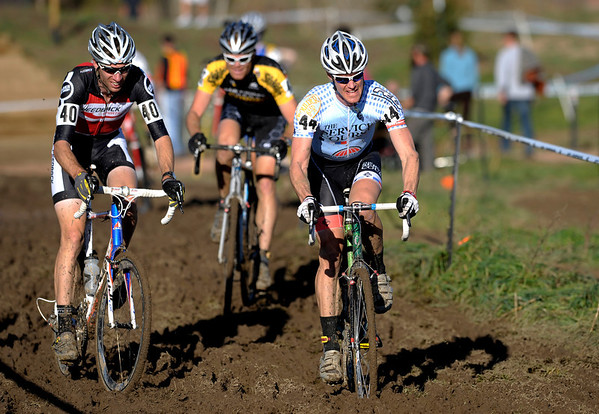 Ken Benesh (left) and Michael Friedberg (right) race through the mud during the Men's Elite race of The Boulder Cup at the Valmont Bike Park in Boulder, Colorado October 30, 2011.  CAMERA/Mark Leffingwell
