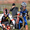 William Iaia (right) passes Scott Tietzel (left) carrying his bike through the mud during the Men's Elite race of The Boulder Cup at the Valmont Bike Park in Boulder, Colorado October 30, 2011.  CAMERA/Mark Leffingwell