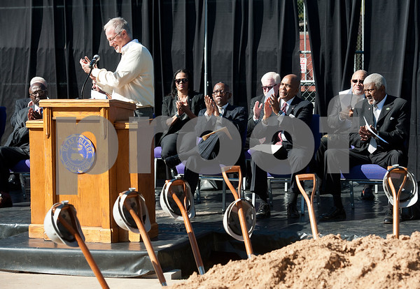 photo by Sarah A. Miller/Tyler Morning Telegraph  Texas College administrators and Board of Trustees members applaud along with Tyler Mayor Martin Heines, pictured at podium, during a groundbreaking ceremony for the first phase of a proposed four phase building and renovation plan for Texas College Thursday Oct. 30, 2014 in Tyler, Texas. The college will be constructing a new residence hall for students.