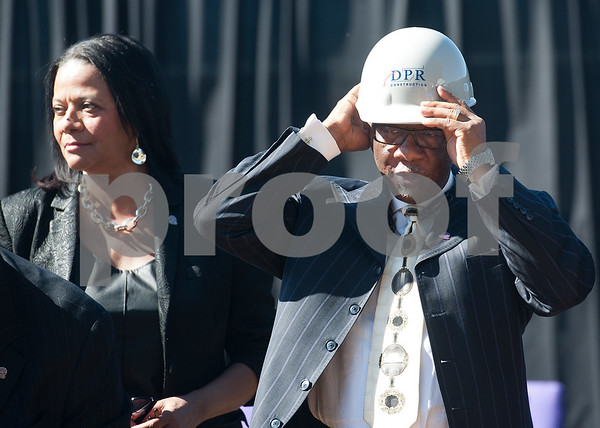 photo by Sarah A. Miller/Tyler Morning Telegraph  Dr. Jerry Christian, acting chairman of Texas College's Board of Trustees, puts on his hardhat during a groundbreaking ceremony for the first phase of a proposed four phase building and renovation plan for Texas College Thursday Oct. 30, 2014 in Tyler, Texas. The college will be constructing a new residence hall for students.