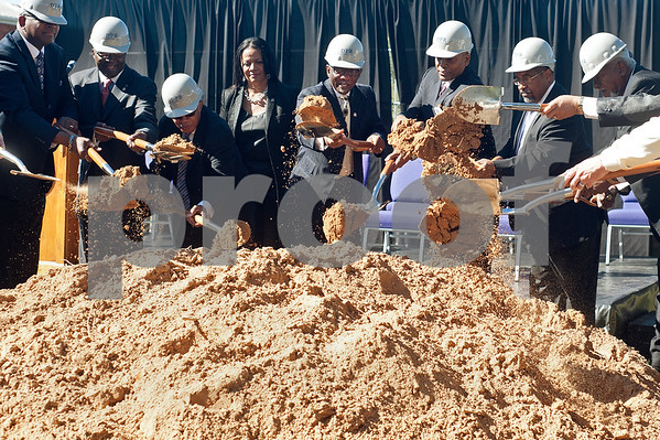 photo by Sarah A. Miller/Tyler Morning Telegraph  Texas College administrators and members of the Board of Trustees lift dirt with their shovels as part of the groundbreaking ceremony for the first phase of a proposed four phase building and renovation plan for Texas College Thursday Oct. 30, 2014 in Tyler, Texas. The college will be constructing a new residence hall for students.