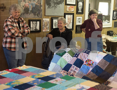 The Sewing Sisters of Texas members Doris Stibbins, Joy Lewis and Georgia Matthews meet Wednesday Oct. 25, 2017. The Sewing Sisters of Texas is a non-profit group women whose main focus is making quilts for children of military members who go to camp through sponsorship by the Seven Stars Foundation. The group meets at a gallery in Frankston to make quilts together. The majority of their fabrics and notions come from donations.   (Sarah A. Miller/Tyler Morning Telegraph)