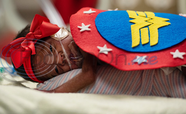 Infant Calixta Renteria wears a Wonderwoman costume at the Neonatal Intensive Care Unit (NICU) at Christus Trinity Mother Frances Hospital-Tyler on Wednesday, Oct. 30, 2019. NICU nurses provided free costumes for each child in the NICU for their first Halloween.  (Sarah A. Miller/Tyler Morning Telegraph)
