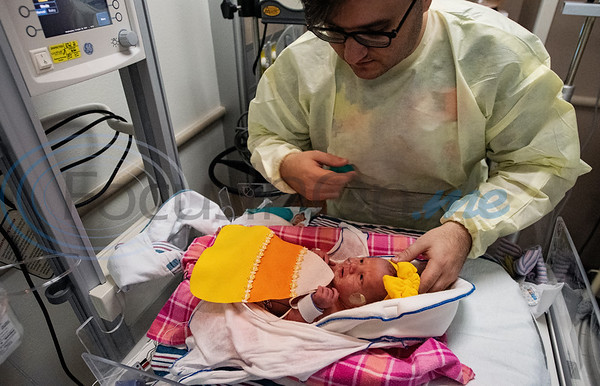 First-time father Grant Jordy, 30, of Flint, tends to his three-day-old daughter Clarabeth Jordy, as she's dressed as candy corn at the Neonatal Intensive Care Unit (NICU) at Christus Trinity Mother Frances Hospital-Tyler on Wednesday, Oct. 30, 2019. NICU nurses provided free costumes for each child in the NICU for their first Halloween.  (Sarah A. Miller/Tyler Morning Telegraph)