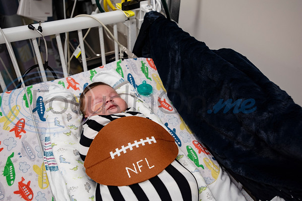 Two-week-old Briggs Prather of Bullard takes a nap dressed as a football at the Neonatal Intensive Care Unit (NICU) at Christus Trinity Mother Frances Hospital-Tyler on Wednesday, Oct. 30, 2019. NICU nurses provided free costumes for each child in the NICU for their first Halloween.  (Sarah A. Miller/Tyler Morning Telegraph)