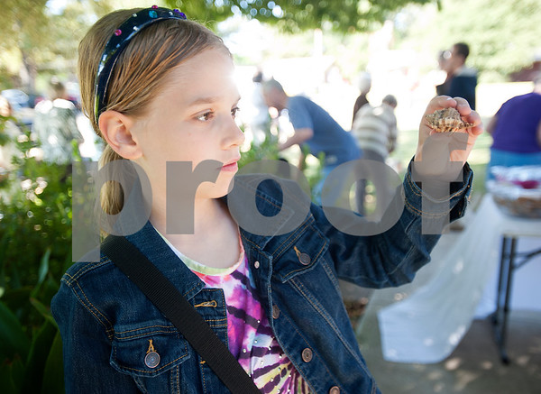 Marley Johnson, 10, holds her pet hermit crab named Autumn as she waits for the Rev. Mitch Tollett to bless the animal in the front lawn of St. Francis Episcopal Church, 3232 Jan Ave., in Tyler Saturday morning. Many Episcopal churches hold a special ceremony to bless pets and animals on or near the feast day of St. Francis of Assisi.  (Sarah A. Miller/Tyler Morning Telegraph)
