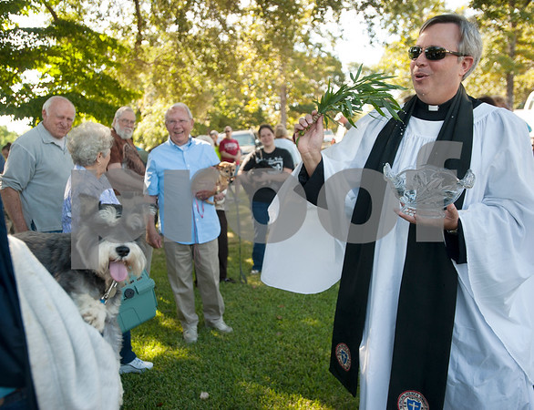 Rev. Mitch Tollett blesses pets in the front lawn of St. Francis Episcopal Church, 3232 Jan Ave., in Tyler Saturday morning. Many Episcopal churches hold a special ceremony to bless pets and animals on or near the feast day of St. Francis of Assisi.  (Sarah A. Miller/Tyler Morning Telegraph)