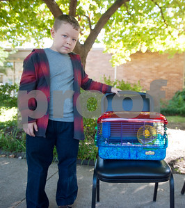 Chance Lee, 6, waits with his hamster Will for the Rev. Mitch Tollett to bless the animal in the front lawn of St. Francis Episcopal Church, 3232 Jan Ave., in Tyler Saturday morning. Many Episcopal churches hold a special ceremony to bless pets and animals on or near the feast day of St. Francis of Assisi.  (Sarah A. Miller/Tyler Morning Telegraph)