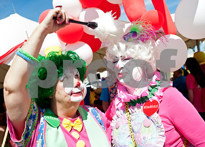 """Sisters-in-law Linda """"Greenie"""" Green and Claudette """"Miss Motzi"""" Webb of Midland tease each other at the Big Top Superstar Extravaganza at the Texas Clown Association Convention at the Holiday Inn in Tyler, Texas Saturday Oct. 3, 2015. The extravaganza was an event for the clowns to perform under a circus tent for special needs children and adults.   (Sarah A. Miller/Tyler Morning Telegraph)"""