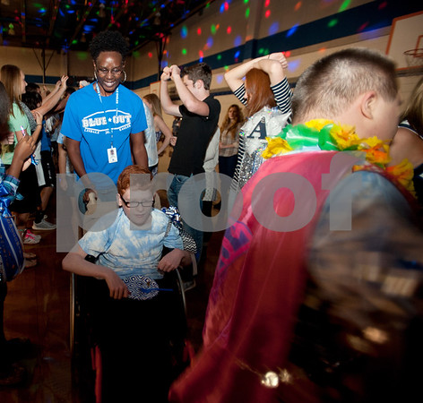 Administrative assistance Sarah Griffin assists Zachary Vickers, 16, in a dance during a special homecoming dance at Lindale High School Friday for 16 students with physical or mental handicaps. It was Lindale's first homecoming dance for special needs students.   (Sarah A. Miller/Tyler Morning Telegraph)