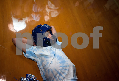 Nicholas Andreason relaxes on the floor during a special homecoming dance at Lindale High School Friday for 16 students with physical or mental handicaps. It was Lindale's first homecoming dance for special needs students.   (Sarah A. Miller/Tyler Morning Telegraph)