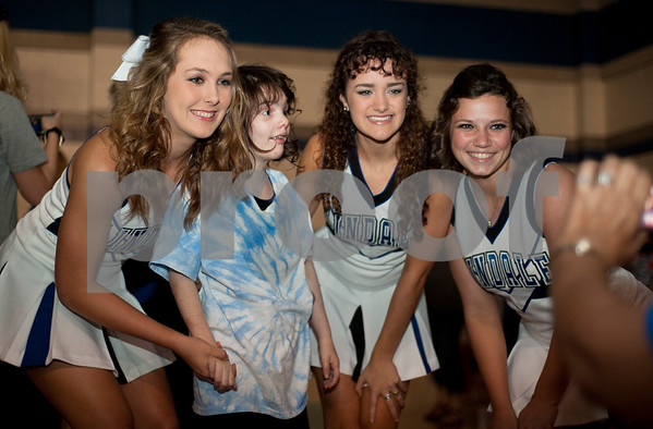 Cheerleaders Bailey Rogers, Baelyn Campbell and Emily Aubuchon pose for a photograph with Aubrey Jones, 17, during a special homecoming dance at Lindale High School Friday for 16 students with physical or mental handicaps. It was Lindale's first homecoming dance for special needs students.   (Sarah A. Miller/Tyler Morning Telegraph)