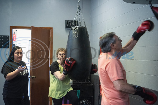 UT-Tyler nursing student Melissa Rodriguez times an exercise session for Joyce Stanley and Connie Hudson during the Rock Steady Boxing Program for Parkinson's disease patients at Tyler Kung Fu ad Fitness on Monday, Oct. 7, 2019. Parkinson's patients in the class train in boxing drills and maneuvers such as hitting punching bags and shuffling along a straight line to help them build strength and balance.  (Sarah A. Miller/Tyler Morning Telegraph)