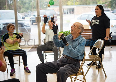 Dick Kronenberg sees tries to drop the ball the least during the Rock Steady Boxing Program for Parkinson's disease patients at Tyler Kung Fu ad Fitness on Monday, Oct. 7, 2019. Parkinson's patients in the class train in boxing drills and maneuvers such as hitting punching bags and shuffling along a straight line to help them build strength and balance.  (Sarah A. Miller/Tyler Morning Telegraph)