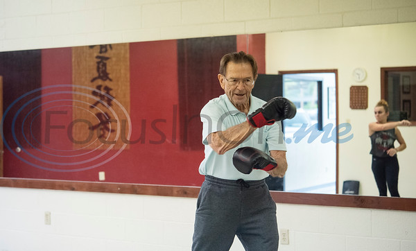 Neal Pock, a retired doctor completes an obstacle course during the Rock Steady Boxing Program for Parkinson's disease patients at Tyler Kung Fu ad Fitness on Monday, Oct. 7, 2019. Parkinson's patients in the class train in boxing drills and maneuvers such as hitting punching bags and shuffling along a straight line to help them build strength and balance.  (Sarah A. Miller/Tyler Morning Telegraph)