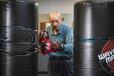 Dr. Dick Kronenberg alternates punches during the Rock Steady Boxing Program for Parkinson's disease patients at Tyler Kung Fu ad Fitness on Monday, Oct. 7, 2019. Parkinson's patients in the class train in boxing drills and maneuvers such as hitting punching bags and shuffling along a straight line to help them build strength and balance.  (Sarah A. Miller/Tyler Morning Telegraph)