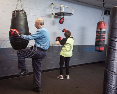Dr. Dick Kronenberg and Joyce Stanley work out during the Rock Steady Boxing Program for Parkinson's disease patients at Tyler Kung Fu ad Fitness on Monday, Oct. 7, 2019. Parkinson's patients in the class train in boxing drills and maneuvers such as hitting punching bags and shuffling along a straight line to help them build strength and balance.  (Sarah A. Miller/Tyler Morning Telegraph)