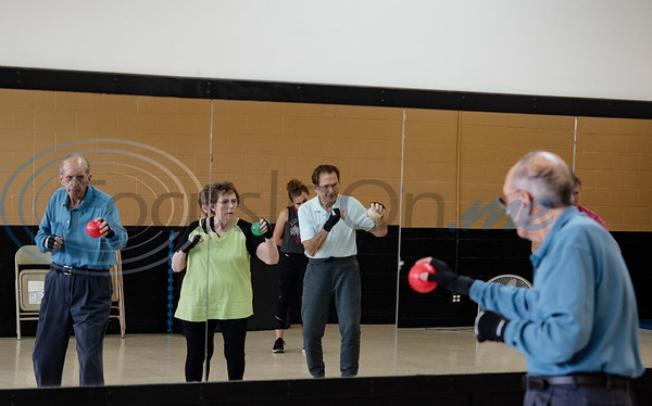 Parkinson's patients Dick Kronenberg, Joyce Stanley and Neal Pock, shadow box during the Rock Steady Boxing Program for Parkinson's disease patients at Tyler Kung Fu ad Fitness on Monday, Oct. 7, 2019. Parkinson's patients in the class train in boxing drills and maneuvers such as hitting punching bags and shuffling along a straight line to help them build strength and balance.  (Sarah A. Miller/Tyler Morning Telegraph)