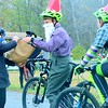 Participants in the costume race on Sunday finished by collecting candy from the organizer's wife, Rachel Payne. About two dozen cyclists of all ages dressed up for the Wicked Creepy Cyclocross Race at Willow Park. Sunday, Oct. 30, 2016. Makayla McGeeney