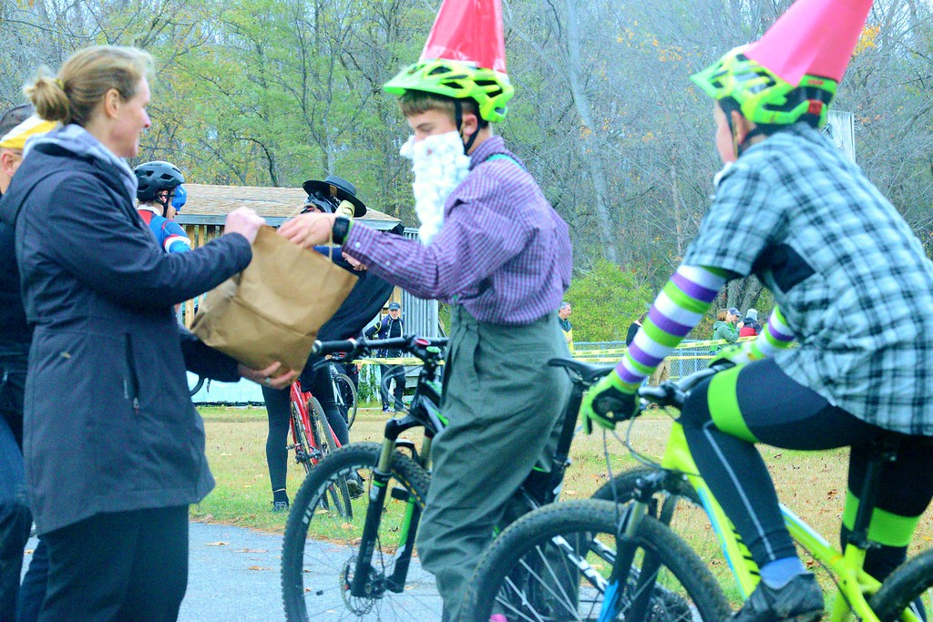 . Participants in the costume race on Sunday finished by collecting candy from the organizer\'s wife, Rachel Payne. About two dozen cyclists of all ages dressed up for the Wicked Creepy Cyclocross Race at Willow Park. Sunday, Oct. 30, 2016. Makayla McGeeney