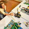 KRISTOPHER RADDER — BRATTLEBORO REFORMER<br /> Marta Bernbaum, a judge,  looks at a Lego project that resembles a crane during the 11th annual Lego Awards Ceremony & Exhibit at the Brattleboro Museum and Art Center on Thursday, Nov. 8, 2018.