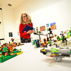 KRISTOPHER RADDER — BRATTLEBORO REFORMER<br /> Linda Whelihan, a judge, examines different Lego project creations during the 11th annual Lego Awards Ceremony & Exhibit at the Brattleboro Museum and Art Center on Thursday, Nov. 8, 2018.