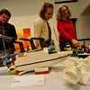 KRISTOPHER RADDER — BRATTLEBORO REFORMER<br /> Linda Whelihan, Marta Bernbaum, and Bob Parks, judges for the Lego contest, take notes of their favorites during the 11th annual Lego Awards Ceremony & Exhibit at the Brattleboro Museum and Art Center on Thursday, Nov. 8, 2018.