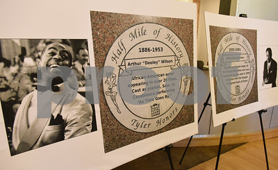 """Half Mile of History renderings are unveiled at Gallery Main Street in Downtown Tyler Tuesday Jan. 10, 2016 for actor Arthur """"Dooley"""" Wilson and gospel singer Willie Neal Johnson. The Half Mile of History is a permanent, outdoor, half-mile loop that surrounds the Square in the heart of Downtown Tyler.  Stone plaques are placed in the sidewalk along the Half Mile of History to commemorate significant people, places or events.  (Sarah A. Miller/Tyler Morning Telegraph)"""
