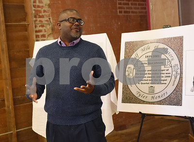 """Stanley Cofer of Empowerment Community Development Co. speaks at the unveiling ceremony for two new Half Mile of History markers in Downtown Tyler Tuesday Jan. 10, 2016. A stone for Willie Neal Johnson will be placed in the Half Mile of History heritage trail along with Arthur """"Dooley"""" Wilson.  (Sarah A. Miller/Tyler Morning Telegraph)"""