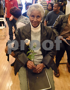 """Captoria Johnson, wife of Willie Neal Johnson, accepts a rose at the unveiling ceremony for two new Half Mile of History markers in Downtown Tyler Tuesday Jan. 10, 2016. A stone for Willie Neal Johnson will be placed in the Half Mile of History heritage trail. Johnson was a gospel singer from Tyler known as """"Country Boy."""" A stone for Arthur """"Dooley"""" Wilson, an actor, was also unveiled Tuesday. The Half Mile of History is a permanent, outdoor, half-mile loop that surrounds the Square in the heart of Downtown Tyler.  Stone plaques are placed in the sidewalk along the Half Mile of History to commemorate significant people, places or events.  (Sarah A. Miller/Tyler Morning Telegraph)"""