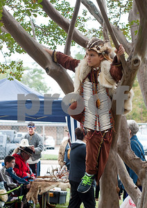 photo by Sarah A. Miller/Tyler Morning Telegraph  Jared Hill, 9, of Longview plays in a tree between sessions of performing Native American dances and drumming with the Boy Scouts Cherokee Trace Chapter Tejas Lodge of the Arrow at the Henderson Heritage Syrup Festival Saturday in Henderson, Texas. The festival commemorates the tradition of ribbon cane syrup making with a live demonstration using antique mule powered equipment to produce old fashioned cane syrup. The one day festival features other folk artist demonstrations including soap making, rope making, basket making, blacksmithing, wood carving, quilting, and other old-time survival skills.