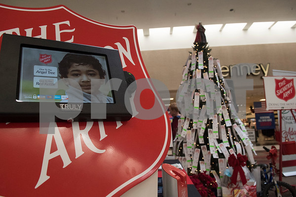 An electronic donation machine allows shoppers to give money via credit or debit card during The Salvation Army Christmas Kick-Off Friday Nov. 10, 2017 at Broadway Square Mall. The Christmas Kick-Off launches The Salvation Army's 2017 Kettle and Angel Tree season. Volunteers will have the chance to ring bells with the iconic red kettle at over 37 locations around Smith County this year. The Salvation Army also registered over 2,500 children as Angels on the Angel Tree this year.   (Sarah A. Miller/Tyler Morning Telegraph)