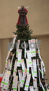 Children's wishes for presents hang on the Angel Tree during The Salvation Army Christmas Kick-Off Friday Nov. 10, 2017 at Broadway Square Mall. The Christmas Kick-Off launches The Salvation Army's 2017 Kettle and Angel Tree season. Volunteers will have the chance to ring bells with the iconic red kettle at over 37 locations around Smith County this year. The Salvation Army also registered over 2,500 children as Angels on the Angel Tree this year.   (Sarah A. Miller/Tyler Morning Telegraph)