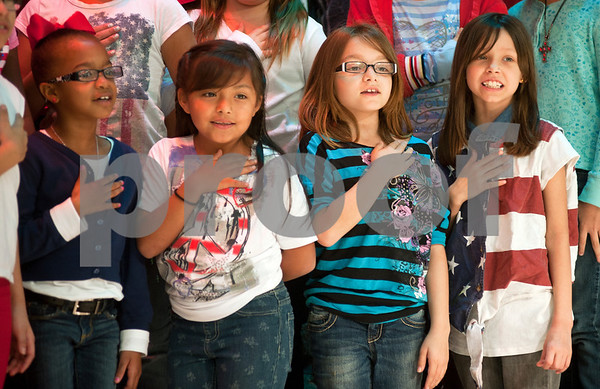 photo by Sarah A. Miller/Tyler Morning Telegraph  Bell Elementary School students sing the Star-Spangled Banner during their Veterans Day program at the school in Tyler Monday.