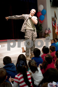 photo by Sarah A. Miller/Tyler Morning Telegraph   Texas State Representative and U.S. Navy Reserve Lt. Commander Matt Schaefer explains the different parts of a military uniform during a Veterans Day program at Bell Elementary School in Tyler Monday.