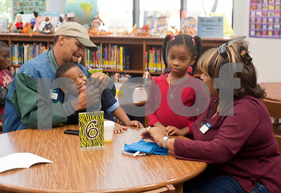 photo by Sarah A. Miller/Tyler Morning Telegraph   Abe Johnson, an Air Force veteran and his wife Myra spend time with their grandchildren John Jernigan, 5, and Brooke Jernigan, 7, after the Bell Elementary School Veterans Day program at the school in Tyler.