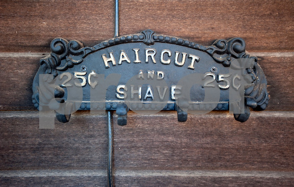 A vintage haircut sign hangs at Tony's Barber Shop Wednesday Oct. 28, 2015. It was Tony Carter's last day of work before retiring from the shop, located at 16355 Farm-to-Market 344 next to the Emerald Bay subdivision. Carter had a barbering career of 52 years and 10 months.   (Sarah A. Miller/Tyler Morning Telegraph)