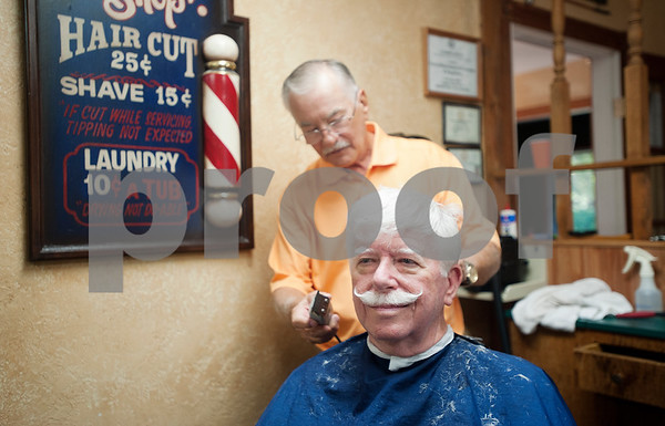 Barber Tony Carter gives longtime customer Jerry Ward of Whitehouse a haircut on his final day working at Tony's Barber Shop Wednesday Oct. 28, 2015. Carter retired from the shop, located at 16355 Farm-to-Market 344 next to the Emerald Bay subdivision, after 12 years in Bullard and an overall 52 year barbering career.   (Sarah A. Miller/Tyler Morning Telegraph)