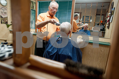 Barber Tony Carter gives a haircut to customer Chuck Smith of Bullard at Tony's Barber Shop Wednesday Oct. 28, 2015. It was Carter's last day of work before retiring from the shop, located at 16355 Farm-to-Market 344 next to the Emerald Bay subdivision. Carter had a barbering career of 52 years and 10 months.   (Sarah A. Miller/Tyler Morning Telegraph)