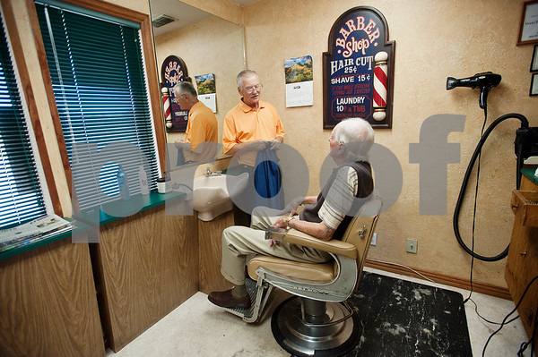 """Barber Tony Carter gives his final haircut to customer Woody Woodall at Tony's Barber Shop Wednesday Oct. 28, 2015. It was Carter's last day of work before retiring from the shop, located at 16355 Farm-to-Market 344 next to the Emerald Bay subdivision. Woodall was Carter's final customer. Carter had a barbering career of 52 years and 10 months. """"I don't remember my first customer, but I'm going to remember my last,"""" Carter said.  (Sarah A. Miller/Tyler Morning Telegraph)"""