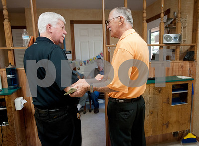 Longtime customer Jerry Ward of Whitehouse, left, says goodbye to barber Barber Tony Carter on his final day working at Tony's Barber Shop Wednesday Oct. 28, 2015. Carter retired from the shop, located at 16355 Farm-to-Market 344 next to the Emerald Bay subdivision, after 12 years in Bullard and an overall 52 year barbering career.   (Sarah A. Miller/Tyler Morning Telegraph)