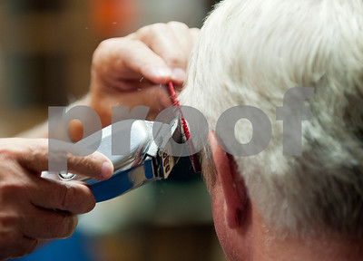 """Barber Tony Carter gives a haircut to customer Dennis Rogers of Bullard at Tony's Barber Shop Wednesday Oct. 28, 2015. It was Carter's last day of work before retiring from the shop, located at 16355 Farm-to-Market 344 next to the Emerald Bay subdivision. Carter had a barbering career of 52 years and 10 months. """"I might have to get a ponytail from here on out,"""" Rogers said.  (Sarah A. Miller/Tyler Morning Telegraph)"""