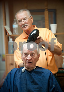Barber Tony Carter dries Woody Woodall's hair at Tony's Barber Shop Wednesday Oct. 28, 2015. It was Carter's last day of work before retiring from the shop, located at 16355 Farm-to-Market 344 next to the Emerald Bay subdivision. Woodall was Carter's final customer. Carter had a barbering career of 52 years and 10 months.  (Sarah A. Miller/Tyler Morning Telegraph)